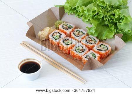 Japanese Sushi To Go. Biodegradable Take Away Craft Box With Sushi Maki Rolls California. Asian Food