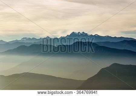 Mountains between clouds, Pico Cristobal Colon, Pico Simon Bolivar, Highest peaks of Colombia at 5700 meters of elevation with snow on top, viewed from Cuchilla San Lorenzo
