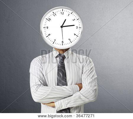 Businessman with alarm clock on hea