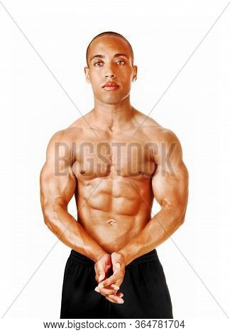 A Young Man Standing In The Studio With His Hands Folded Showing His Great Physique And Muscles, Iso