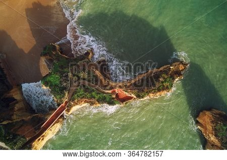 Aerial Photo Directly From Above View Ponta Da Piedade Headland With Group Of Rock Formations Yellow