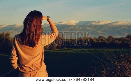 Back View Slim Young Woman Enjoy Sierra Nevada Ridge Mountains View. Female Traveller Looking Observ