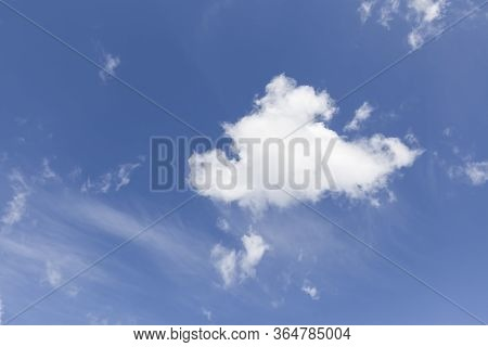 Single White Cloud On A Blue Sky Background