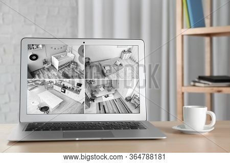 Laptop With View From Cctv Cameras. Home Security System