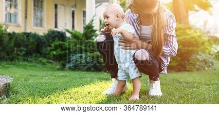 Teen Nanny With Cute Baby On Green Grass Outdoors, Space For Text. Banner Design