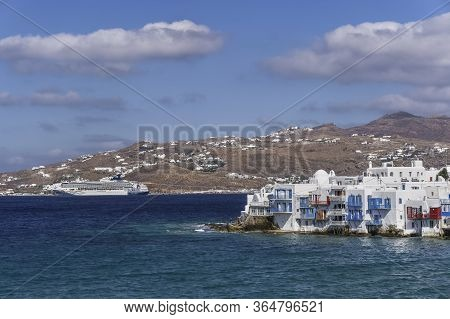 Mykonos, Greece - October 27 2017: Norwegian Spirit Cruise Line Ship Moored Against Greek Island Lan