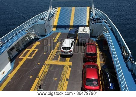 Genova, Italy: Feb 1, 2020 - Loading Of Cars On The Large Blue Ferry-vessel In Italy