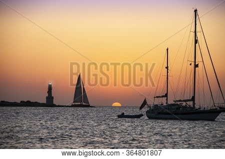 Sunset Over The Sea, Boats At Anchor With A Sky Of A Thousand Colors. Panoramic Sunset View Formente