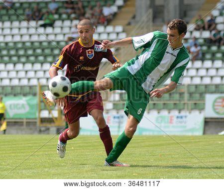 KAPOSVAR, HUNGARY - AUGUST 26: Krisztian Kirchner  (in green) in action at a Hungarian Championship II. soccer game Kaposvar II. (green) vs. Paks II. (claret) August 26, 2012 in Kaposvar, Hungary.