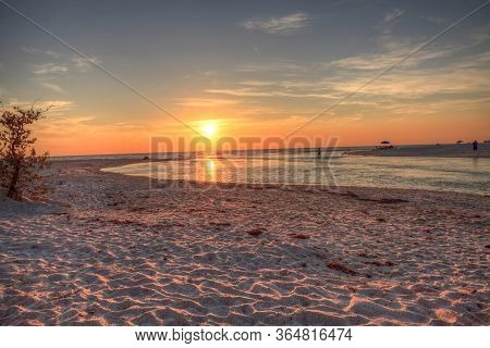 Sunset Over The Beach As A Waterway Of Clam Pass