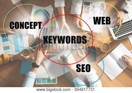 Keywords Research Concept. Team Of Seo Specialists Working At Table, Top View