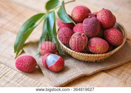 Lychee Slice Peeled On Wooden / Fresh Lychee With Green Leaves Harvest In Basket From Tree Tropical
