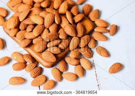 Almonds Nuts On Wooden Board Background Almonds Top View / Roasted Almond For Snack