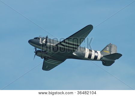 EASTBOURNE, ENGLAND - AUGUST 11, 2012: Douglas C-47A Dakota, 2100884, performs at the Airbourne airshow on August 11, 2012 at Eastbourne, East Sussex. Shown in USAF livery with D Day invasion stripes.