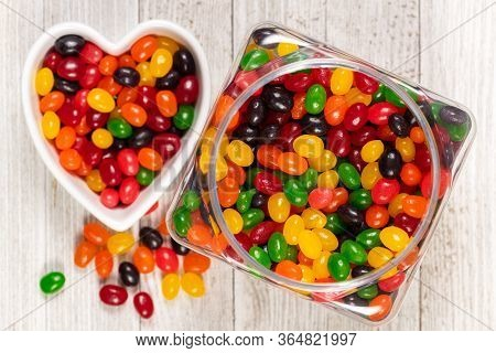 Assorted Colourful Black, Red, Green, Yellow, And Orange Jelly Beans, Sweet Candy Background With A