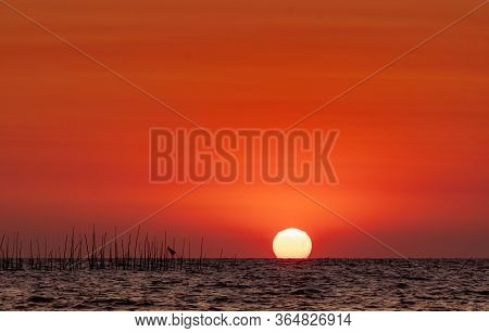 Big Sun Over The Sea At Sunset. Beautiful Sunset Sky And Skyline. Red Romantic Sky For Peaceful And