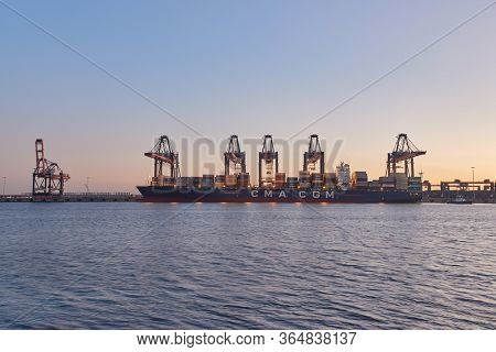 ROTTERDAM, THE NETHERLANDS - SEPTEMBER 20, 2019: Huge container ship in port being loaded in the Euromax container terminal in the Port of Rotterdam, busiest port cargo port of Europe
