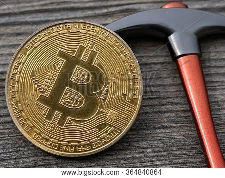 Bitcoin And Pickaxe On Wooden Background, Btc Physical Coin