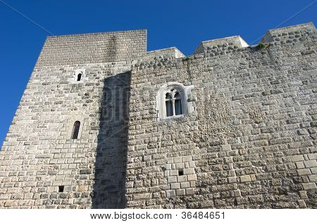a mullioned window in the fortified walls of the Norman-Swabian Castle in the old town of Bari