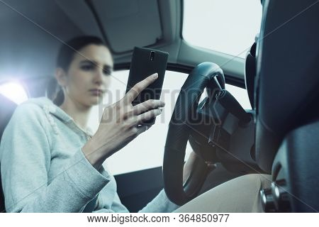 Careless Woman Using A Smartphone In Her Car