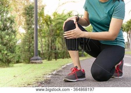 Fitness Woman Runner Feel Pain On Knee. Outdoor Exercise Activities Concept