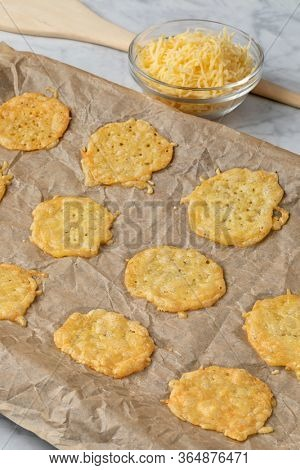 Baked homemade Dutch golden Gouda cheese cookies close up