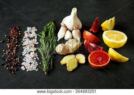 Set Spice On A Black Stone Board. Peppers Mix, Himalayan Salt, Rosemary, Garlic, Lemon, Ginger, Red