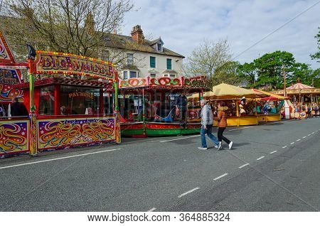 Llandudno, Uk : May 6, 2019: A Sunny Morning Sees Few Visitors To The Street Fair And Entertainment