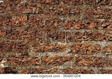Old Laterite Wall Laterite Texture Background,pattern Decorative Uneven Cracked Real Stone Wall Surf
