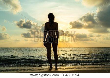 Happy Carefree Woman In Bikini Enjoying Beautiful Sunset On The Beach