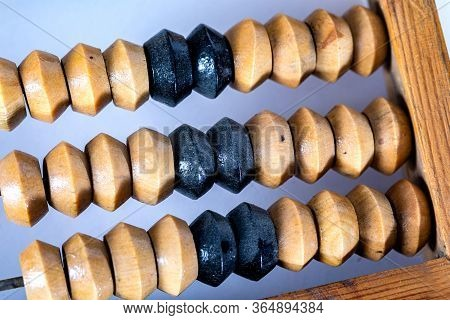 Vintage Wooden Abacus On A White Background. A Device For Arithmetic Operations.