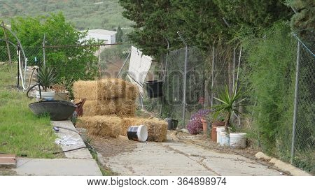 Square Straw Bales Stacked In Dead End Space In Andalusian Village