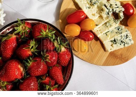 Wooden Plate With Dorblue Blue Cheese And Bowl Of Fresh Red Strawberries.