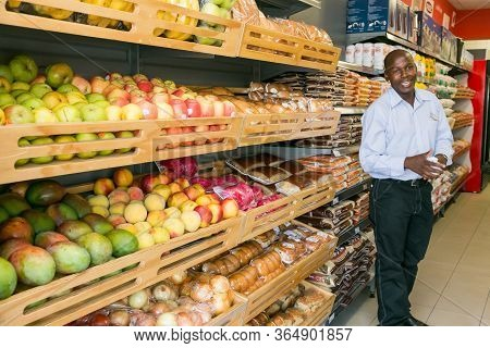 Grocery Store Staff Packing Shelves At Local Pick 'n Pay Spaza Shop