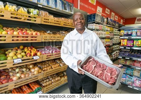 Johannesburg, South Africa - February 24, 2016: Owner Manager Posing With Produce In Isle At Local P