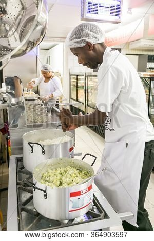 African Male Chef Staff Working In The Kitchen Of Butchery And Deli Section At Local Pick N Pay Groc