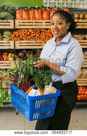 Johannesburg, South Africa - November 22, 2016: Owner Manager Posing With Produce In Isle At Local P