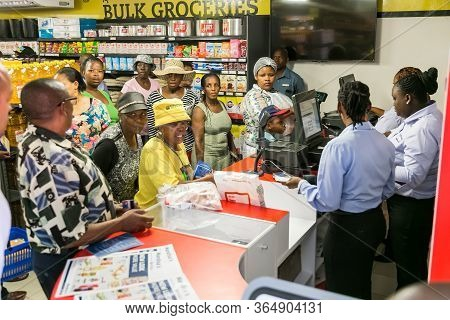 African Cashier And Customer At Checkout At Local Pick N Pay Grocery Store