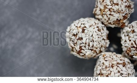 Healthy Raw Energy Balls With Cocoa, Coconut, Sesame, Chia On Grey Background. Healthy Homemade Pale