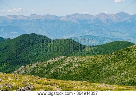 Scenic View To Green Forest Hills With Crags And Long Mountain Range. Awesome Minimalist Alpine Land