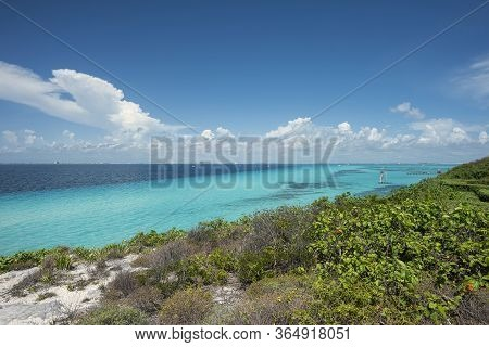 Panoramic View Of The Southern Tip In Isla Mujeres Mexico. In The Background A Group Of Tourists Str