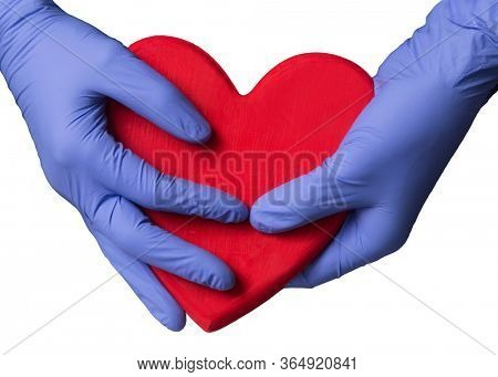 Doctor hands hold and protect a big heart on white background.