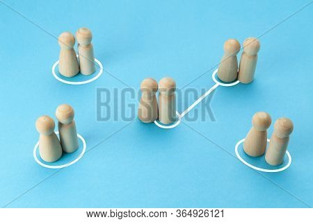 Concept Of Infidelity And Betrayal (treason) In Family Or Married Couple. Wooden Figures With Lines