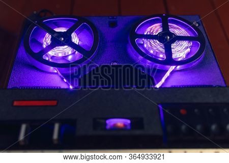reel-to-reel audio tape recorder with violet led light strip