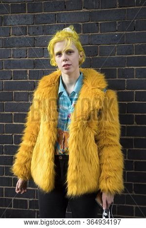 Barcelona, Spain - 13 February, 2020, A Girl With Yellow Hair In A Faux Fur Coat, Blue Shirt With Pa