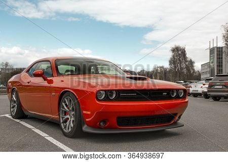 Kiev, Ukraine - April 21, 2020: Muscle Car Dodge Challenger Srt8 392 Hemi In The Parking Lot. Red Ca