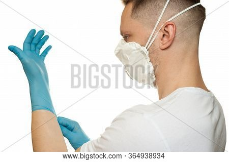 Young Surgeon Doctor In Latex Protective Gloves In White Protection Mask On White Background. Man In