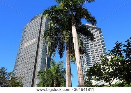 Manila, Philippines - November 28, 2017: Ayala Tower One (left) Skyscraper In Makati City, Metro Man