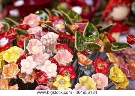 Close Up View Of Several Decorative Colorful Glass Flowers.