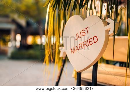 Heart Shape Wedding Sign Design. Honeymoon Concept As Wooden Plate On The Tropical Beach. Tropical L